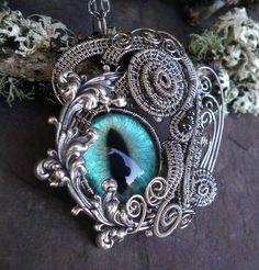 Gothic Steampunk Evil Cat Eye Pendant. $99.95, via Etsy.