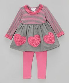 With its contrasting prints and ruffly hearts, this sweet outfit is set to dazzle. The coordinated leggings bring out the pretty pink and finish the look beautifully.