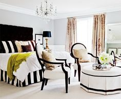 Bedroom. Delightful. Bold black & white stripes with neutrals add a splash of apple green for fun. Style!