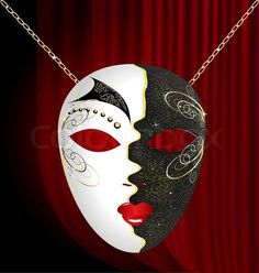 On an red drape is a large black-white venetian mask with black ...