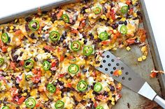Seriously delicious nachos baked on a sheet pan with homemade tortilla chips, black beans, chicken and all the fixings. These Sheet Pan Chicken and Black Bean Nachos are sure to be a family favorite for an easy meal or game day great! Slow Cooker Recipes, Cooking Recipes, Healthy Recipes, Cooking Ideas, Healthy Eats, Delicious Recipes, Healthy Snacks, Yummy Food, Appetizer Recipes