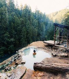 Umpqua Hot Springs is a geothermal pool located along the North Umpqua River in Oregon, USA at 2,640 feet (800 m) elevation. Two oval pools are available for soaking, the larger having a solid rock bottom and the smaller sand. The larger is five by eight feet and 110 °F (43 °C), and is covered by a wooden enclosure. The upper pool is smaller but slightly warmer, measuring four by five feet and 112 °F (44 °C). Both pools are approximately two and a half feet deep. Umpqua is clothing optional…