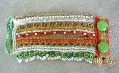 REDUCED PRICE from 59$ to 39$!!!  A unique handmade cuff, crochet from a HQ 100% cotton thread , made with resisting and long-lasting glass beads. The bracelet cuff has a flower clip, which can be added whenever you want. Main colors are orange, beige, light green, cream... This bracelet is decorated with glass beads, crystal color beads and sea glass beads.  I made this cuff by using a Free Form Crochet Technique and a lot of imagination, so it is completely unique and can not be reproduced…
