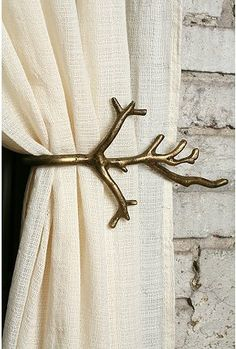 I need to remember to get some sort of curtain tie backs in my house, and these would be perfect in our bedroom