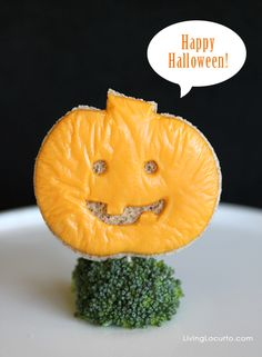 #Halloween Jack o' Lantern Grilled Cheese Sandwiches - A fun food idea by Amy at LivingLocurto.com
