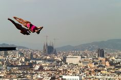 Zsofia Reisinger and Gyongyver Villo Kormos of Hungary compete in the Women's 10m Platform Synchronised Diving final on day three of the 15th FINA World Championships at Piscina Municipal de Montjuic on July 22, 2013 in Barcelona, Spain. (Photo by Clive Rose/Getty Images)