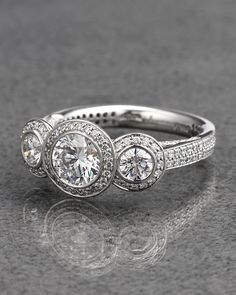 Ritani Platinum Three Stone Diamond Halo Pave Ring - explore our art deco selection http://www.ritani.com/engagement-rings/style/art-deco-engagement-rings
