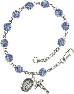 Sterling Silver Rosary Bracelet features 6mm Light Sapphire Swarovski beads. The Crucifix measures 5/8 x 1/4. Each Rosary Bracelet is presented in a deluxe velv