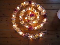 Candle mandala for a self-love/anti-depression spell. Petals, herbs and white candles circling inward to an image of yourself. Meditate on your positive qualities and envision yourself surrounded by a bubble of love that feels like a big warm hug.