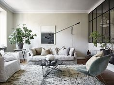styling on fleek | modern neutral living room via Entrance Realtors | chic linen sofa and armchair | green Gubi Beetle lounge chair | marble coffee table | the dream living room | Get inspired and nail the trend with an IKEA Karlstad sofa with a Bemz Loose Fit cover