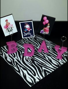 Display birthday pictures at Zebra party