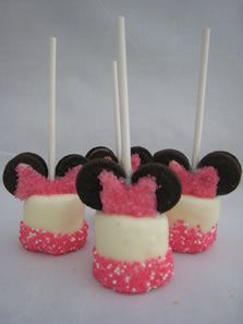 Minnie Mouse marshmallow pops! Perfect for a birthday party! Marshmallow pops - Perfect for sweets tables or party favors. Large marshmallows dipped in your choice of chocolate and layered with sprinkles. For those who like s'mores any time of year, try ours! Milk or dark chocolate dipped marshmallow with graham cracker sprinkles.