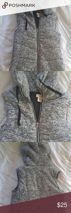 Gray Space Dyed Hooded Vest NWOT. Gray colored vest with black lining on the inside. No pockets. Hood does not come off. Brand new never worn. Wet Seal Jackets & Coats Vests