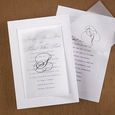 Beauty is created starting with a bright white, card invitation featuring an embossed border. A translucent overlay with your initial adds elegance.
