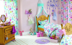 Prestigious Textiles -  Pirates and Princesses Fabric Collection - Girls bedroom with curtains, duvet and pillows with images of princesses and castles in light blue, white and pink