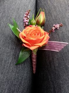 Orange and pink boutonniere for prom and wedding.