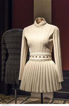 Amongst the show stoppers is the glimmering mini-dress once worn by Tina Turner, dripping with metallic beads, a Josephine Baker–inspired black bra and miniskirt, favored by Naomi campbell and the infamous bandage dress, inspired by Egyptian embalming techniques.