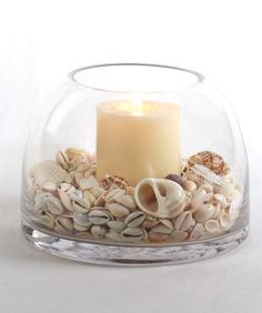 Fill a single bowl with sea shells surrounding a pillar candle for some counter appeal in the powder room.