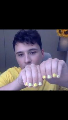 the shades of yellow bother me but i dont even care dan howell is wearing nail polish again and im alive bitch