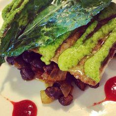 Mahi mahi with avocado cilantro sauce, kale, smoky chipotle black beans