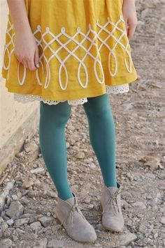 Turquoise tights and mustard skirt with white lace underskirt.  I own this skirt! I only thought of it for summer though...
