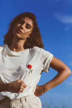 Spice up your white t-shirt game with Between Ten's playful embroidery.