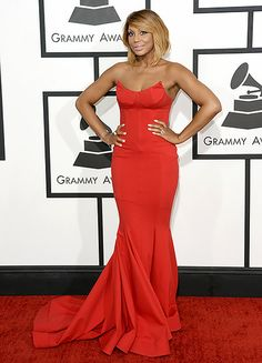 Tamar Braxton wearing a red hot Michael Costello gown at the 2014 Grammy Awards