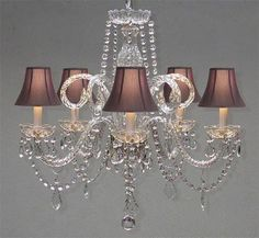 This beautiful Chandelier is trimmed with SPECTRA(tm) CRYSTAL – Reliable crystal quality by Swarovski®! Swarovski® is the world's leading manufacturer of high q
