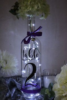 Wedding Table Numbers, Bottle Numbers, Wedding Centre piece vinyl stickers is part of Wedding table centerpieces These bottle numbers are a great way of making your own centre pieces We only use t - Wedding Table Centres, Wedding Table Centerpieces, Wedding Decorations, Table Wedding, Diy Wedding Table Numbers, Table Centre Pieces Wedding, Flower Table Decorations, Table Flowers, Centrepieces