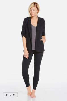 Revamp your off-duty style in our high-shine, liquid black-accented blazer, designed with sleek elbow patches. Throw on a classic tank and liquid black leggings for a solid finish. | Tarragon outfit- Fabletics