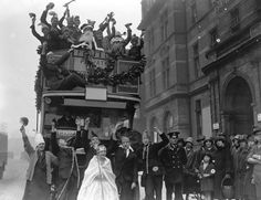 Children from the Royal Caledonian School enjoying a festive Christmas pageant on an open top bus which is carrying Santa and his helpers through the streets. December 1926