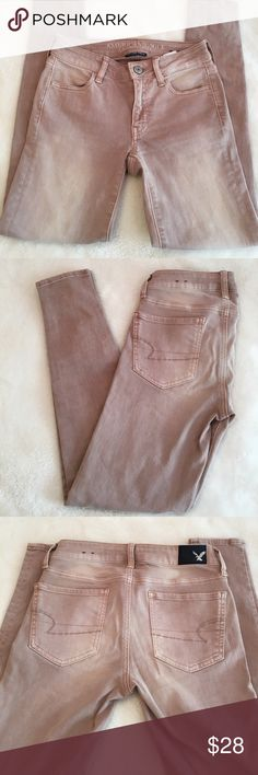 """American Eagle Super Super Stretch Jeans Like new! American Eagle Super Super Stretch skinny leg Jeans in a neutral blush color. Classic 5 pocket styling. 14"""" waist, really stretchy and inseam of 26.5"""". Size 0 short. American Eagle Outfitters Jeans Skinny"""