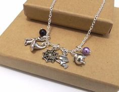 Halloween Necklace, Halloween Trinket Necklace, Witch Necklace, Halloween Jewellery, Halloween Charm Necklace, Witch's Hat, Spider, Cat This is a funky Halloween charm necklace, featuring different shaped charms; a cat, a witch's hat, a spider web, a witch and a cauldron.It's also decorated with your choice of two coloured beads please tell me which colours you would like in the notes section when you check out.The necklace is designed to sit on a longer length chain, but you can choose any…