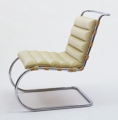 MR Lounge Chair (model 34) Ludwig Mies van der Rohe (American, born Germany. 1886–1969)  1931. Chrome-plated tubular steel and velvet, 33 x 21 5/8 x 35 7/8 (83.8 x 55 x 91.1 cm). Manufactured by Knoll International, Inc., New York, NY. Gift of Knoll International, Inc. © 2013 Artists Rights Society (ARS), New York / VG Bild-Kunst, Bonn