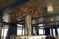 Incredible tree installation composed of hand-crafted steel vine leaves #restaurantdecor #interiordesign #lighting #luxury