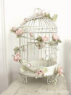 Possibly for wedding or bridal shower. Rose birdcage