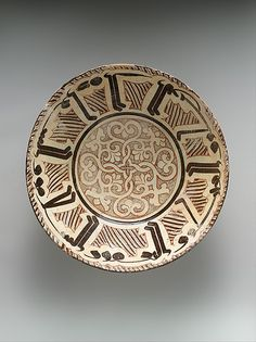 """Bowl with Arabic Inscription, """"Blessing, prosperity, well-being, happiness""""    Object Name:      Bowl  Date:      late 10th–11th century  Geography:      present-day Uzbekistan, probably Samarqand; Iran, Nishapur  Medium:      Earthenware; white slip with polychrome slip decoration under transparent glaze  Dimensions:      Max Diam. 14 in. (35.6 cm) H. 4 1/4 (10.8 cm)  Classification:      Ceramics"""