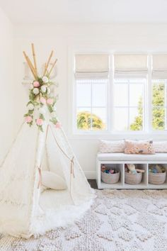 Baby girls nursery with bohemian chic teepee: http://www.stylemepretty.com/living/2016/10/18/20-ways-to-decorate-with-texture-for-the-coziest-of-homes/ Photography: Alyssa Rosenheck - http://alyssarosenheck.com/