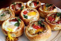 Breakfast Bread Bowl: Use a crusty French bread roll, cut off the top and scoop out the inside, fill it with your favorite ingredients, add an egg or egg white, and bake in the oven until the egg is set. (Add precooked veggies and bacon, tomatoes, cheese, mushrooms, chopped ham, herbs!)