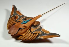 Medium: tōtara, kauri, pāua (New Zealand abalone), brass rod. Size: 4 x 32 x 23 inches. In one account of Māori mythology, the Eagle Ray along with other notorious creatures, such as sharks and other rays, were said to have been the children of an ancestor named Punga. Punga was a son of Tangaroa (god of the sea) and had two sons, Ikatere (swimming fish) and Tū-te-wehiwehi (fear and awe).