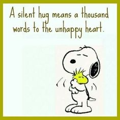 "Snoopy hugging Woodstock. ""A silent hug means a thousand words to the unhappy heart."""