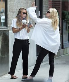 Love the big white jacket/top and skinny black jeans! Perfection!