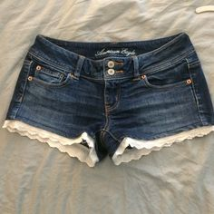 American Eagle Lace Trimmed Blue Jean Shorts Size 4 stretch blue jean shorts with lace trim. Worn minimum amounts--in like new condition. American Eagle Outfitters Shorts Jean Shorts