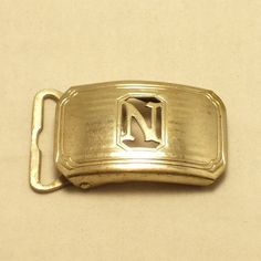 vintage belt buckle ... art deco initial N monogram by SwaggerMan   [excerpted from previous pinner's caption]