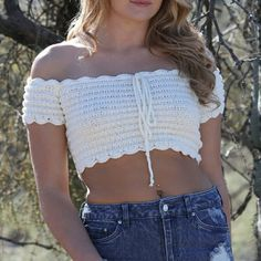 """NWT crochet top Crochet top off shoulder with scallop hem,front drawstring 9"""" length 36.5"""" chest 4.5"""" sleeves #measured from small/medium size# natural color #tagged free people for visibility # see other listing for paired shorts or medium/large size Free People Tops Crop Tops"""