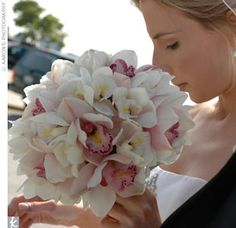 Can anyone post pics pf pink flowers bouquets and centerpieces? :  wedding Orchid Bouquet