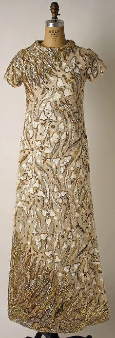 Evening dress Valentino (Italian, born 1932) Date: ca. 1969 Culture: Italian Medium: silk, plastic Dimensions: Length at CB: 57 in. (144.8 cm) Credit Line: Anonymous Gift, 1983