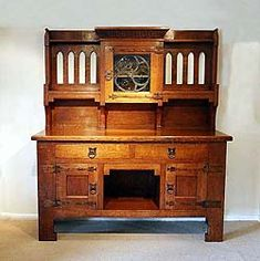 An Arts and Crafts sideboard.  This is epitomizes the Movement.  I have no idea why but I think I came out of the womb, loving the Arts and Crafts Post Modernist McIntosh Schools.