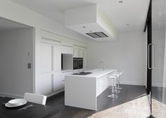 White Kitchen2 Daring Geometry: Black And White House in Kent Sliced Up Into Irregular Shapes