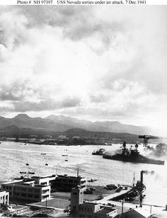 USS Nevada tries to get underway during the Dec. 7, 1941 attack at Pearl Harbor. NHHC photo USS Arizona (BB-39) is in the center, burning furiously. To the left of her are USS Tennessee (BB-43) and the sunken USS West Virginia (BB-48). Official U.S. Navy Photograph, NHHC Collection.